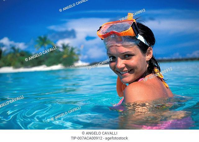Maldives, Ari Atoll. White Sands Island. Woman on beach