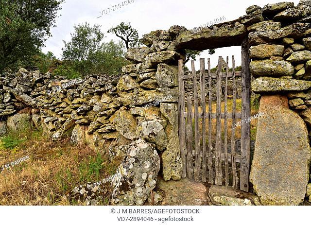 Popular architecture. Door and wall building with granite blocks and wood. Cozcurrita, Sayago, Zamora Province, Castilla-Leon, Spain