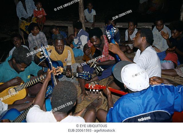 Tanna. Musicians playing guitars at John Frumm service