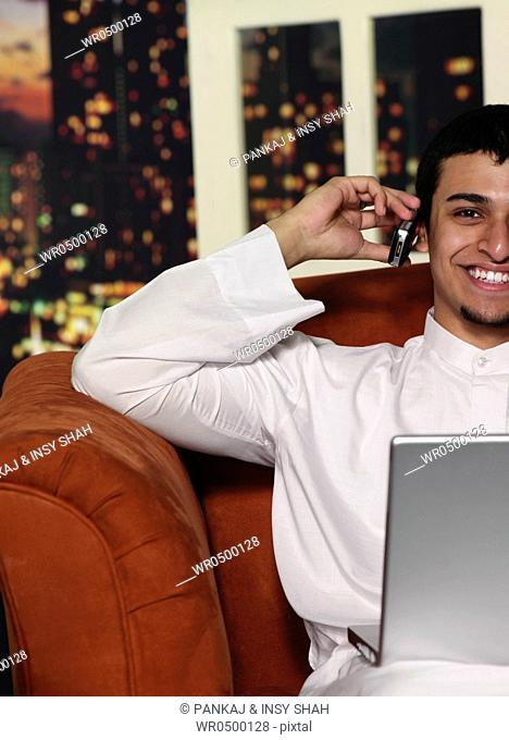 Arab boy on mobile phone