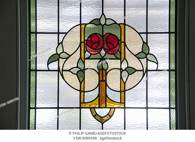 Leadlight glass motifs in a 1913 Art Nouveau Queenslander house, Brisbane, Australia