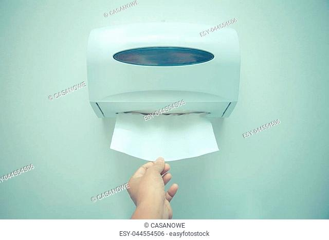 Soft focus tissues paper towel dispenser on wall in barthroom