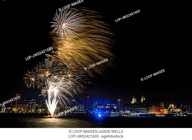Fireworks released from a barge on the River Mersey in Liverpool