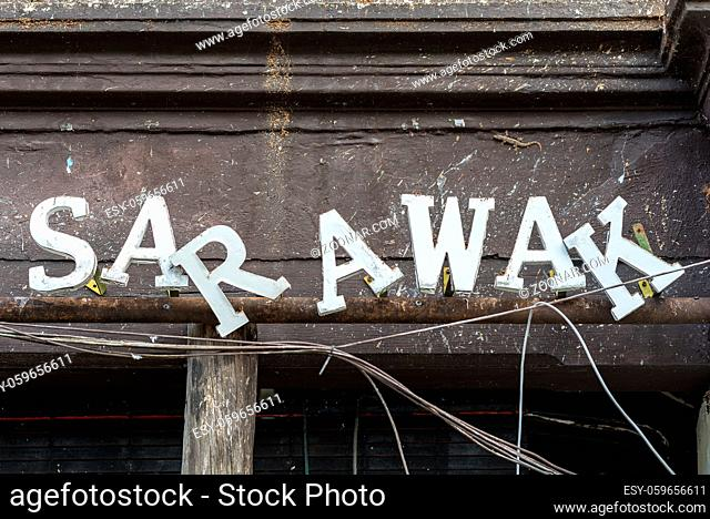 Sarawak lettering on the front side of a closed shophouse in the Chinatown of Kuching in the Sarawak state of Malaysia on Borneo