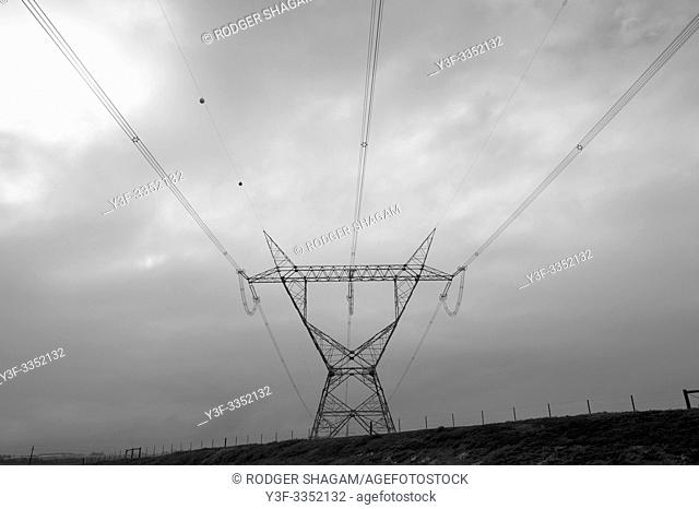 Elecrical cables supported by pylons, carry power across the country. Rural South Africa