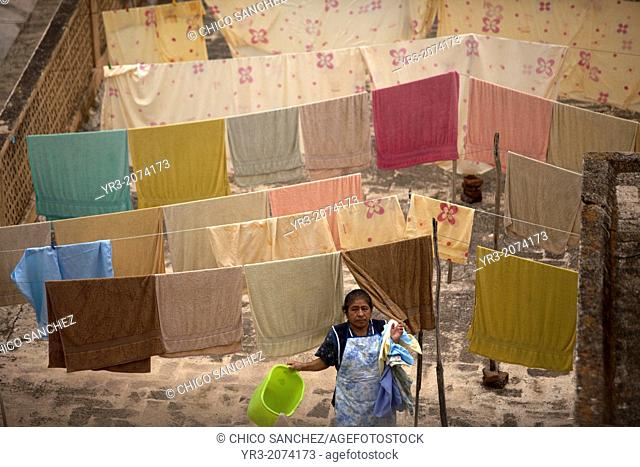 A woman hangs clothes in Oaxaca