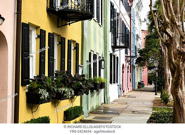 Colorful pastel building facades on Rainbow Row along East Bay Street in historic Charleston, SC