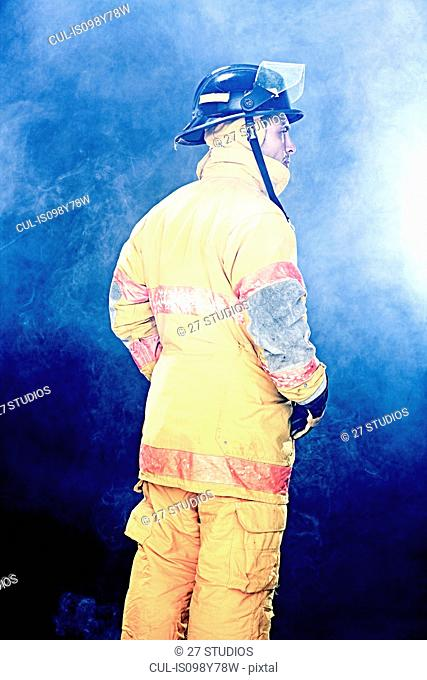 Portrait of firefighter in smoke