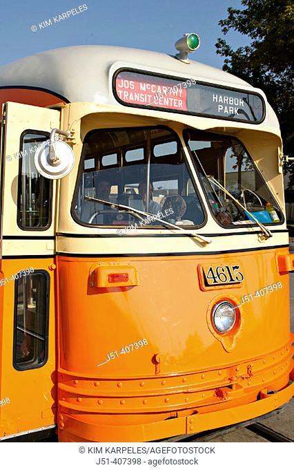USA, Wisconsin, Kenosha. Restored orange streetcar, front of vehicle, route name