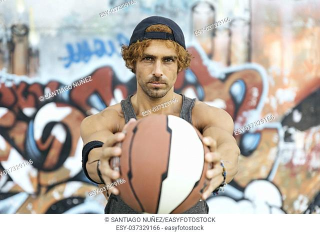 Portrait of Handsome Man with Casual Sport wear and basket ball