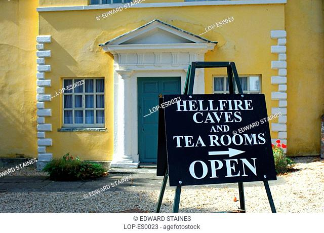England, Buckinghamshire, West Wycombe, Hellfire Caves and tea room sign at West Wycombe. West Wycombe village is owned by the National Trust