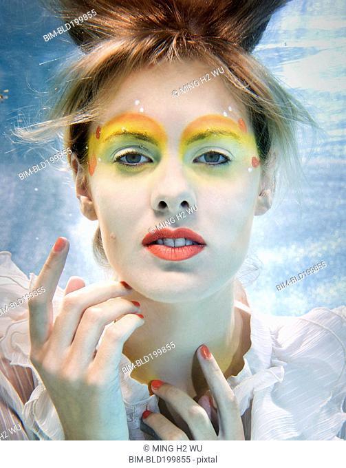 Caucasian woman swimming under water