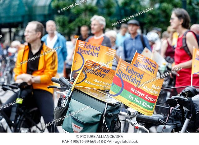 16 June 2019, Hamburg: Cyclists have gathered at the end of the 25th Bicycle Star Ride at the town hall market. Once a year they protest in this form for their...