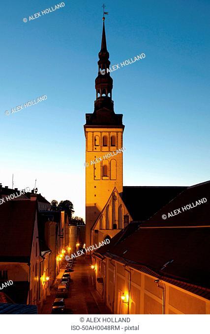 Church steeple overlooking city street