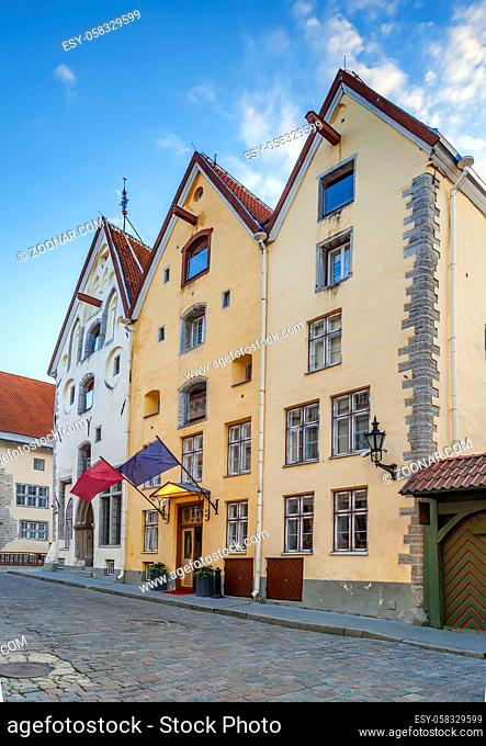 Street with historical houses in Tallinn old town, Estonia. Three sisters