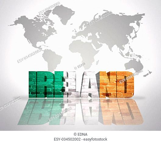 Word Ireland with irish Flag on a world map background