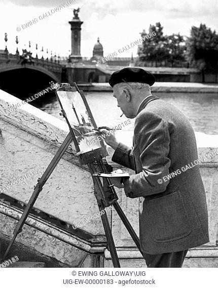 Artist along Seine, Paris, France