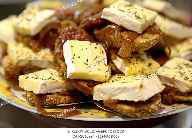 Brie cheese and anchovies. Pintxos, San Sebastian (Donostia), Basque Country, Spain