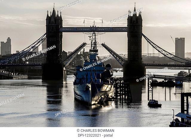 London Bridge and HMS Belfast in River Thames; London, England