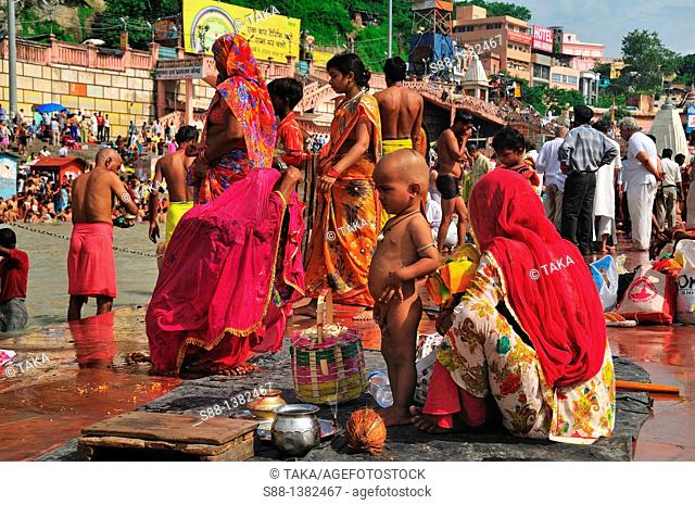 Pilgrims bathing at Har Ki Pairi ghat by the Ganges river