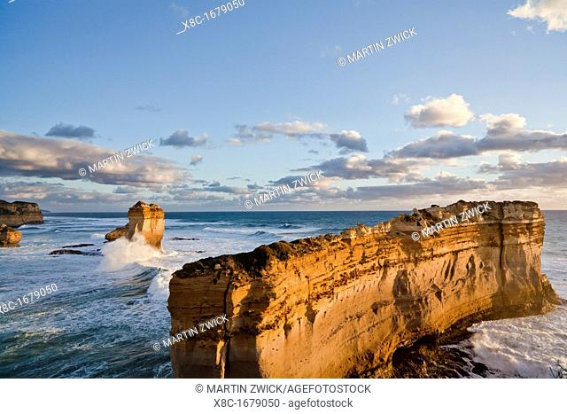 The coastline near Loch Ard Gorge with the sea stack / rock formation called Razorback, looking towards the sea stacks called 12 Apostles, Great Ocean Road