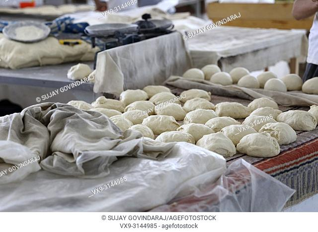 Tashkent, Uzbekistan - May 01, 2017: Wheat dough prepared to make bread in a local hotel