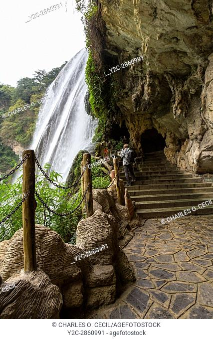 Guizhou Province, China. Trail Emerges from Cave underneath the Yellow Fruit Tree (Huangguoshu) Waterfall