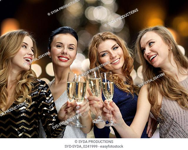 happy women drinking champagne at christmas