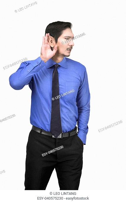 Portrait of asian businessman with hand behind ear posing isolated over white background