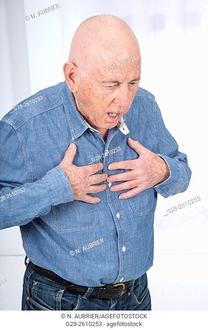 Senior man suffering from angor, respiratory problems, asthma