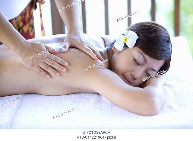 Young woman getting a massage, Saipan, Focus on Foreground
