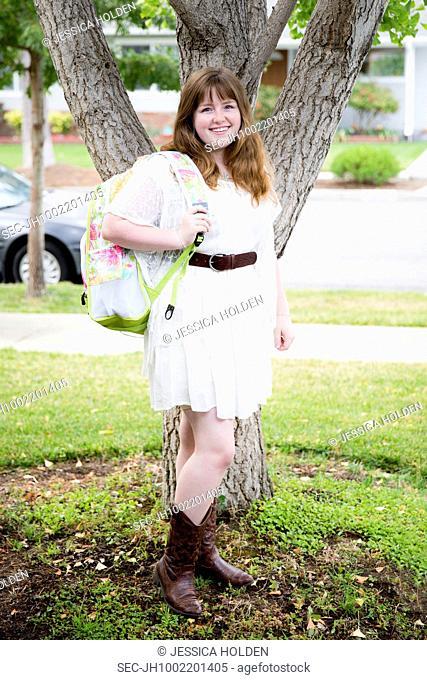 Portrait of teenage girl (13-15) with backpack