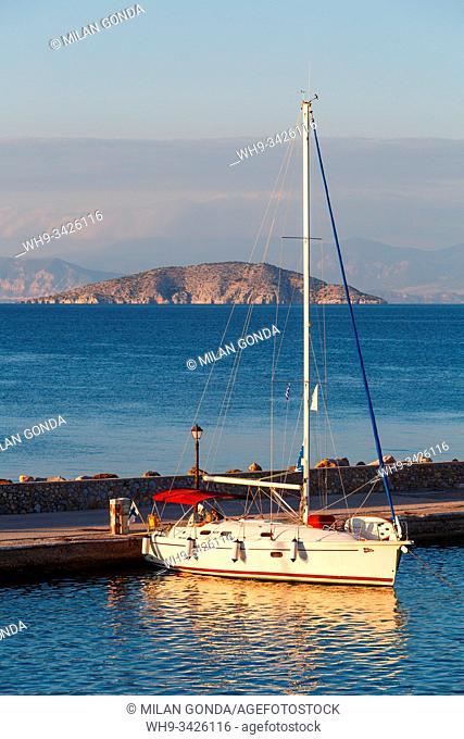 Megalochori, Greece - November 02, 2019: Sail boat in the harbour of Megalochori village on Agistri island, Greece