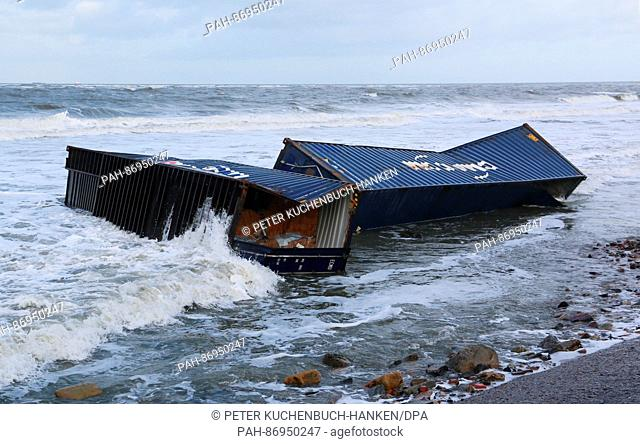 Two ship containers loaded with wood lie on a beach on the island of Wangerooge, Germany, 02 January 2017. A total of eleven containers washed up on beaches in...