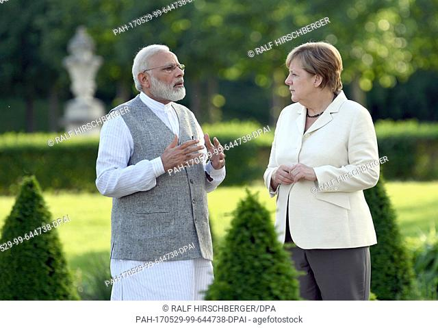 German Chancellor Angela Merkel (CDU) and Indian Prime Minister Narendra Modi in the garden of the German government guest house during the German-Indian...