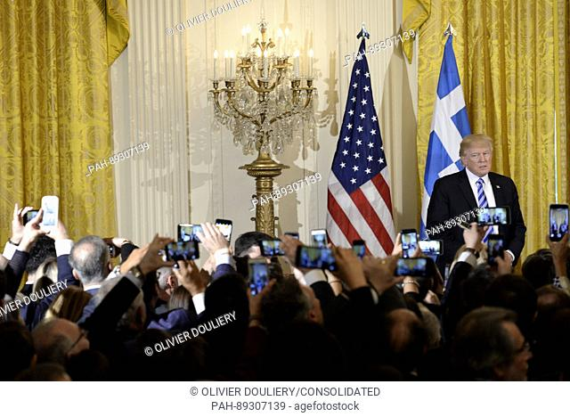 United States President Donald Trump looks on during an event to celebrate Greek Independence Day in the East Room the White House on March 24