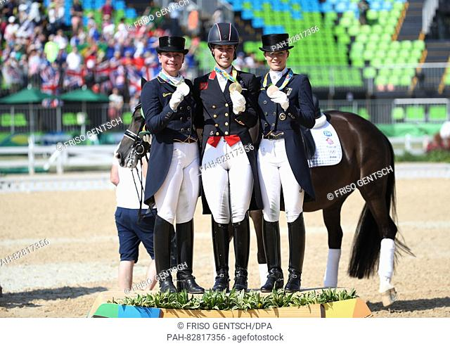 (L-R) Silver medalist Isabell Werth (Weihegold) of Germany, Gold medalist Charlotte Dujardin (Valegro) of Great Britain and Bronze medalist an Kristina...
