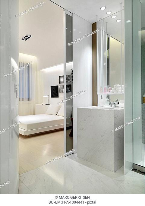 Marble sink outside modern bedroom