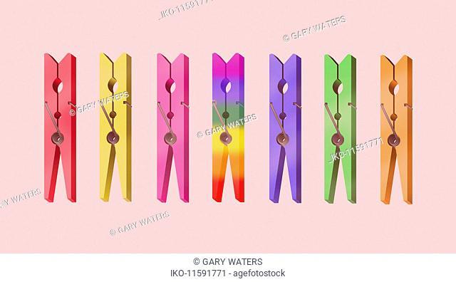 Row of rainbow colour clothes pegs
