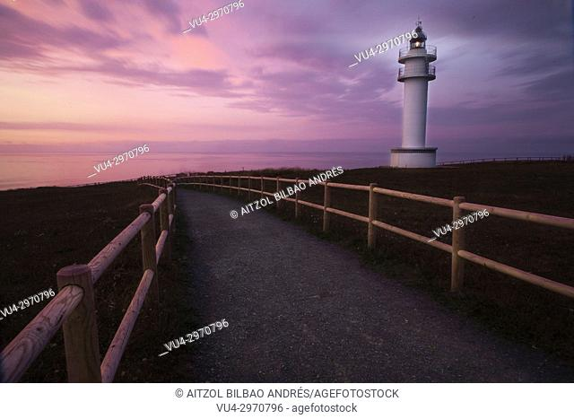 Sunset at Ajo lighthouse, cantabria, spain. The small road creates a nice effect