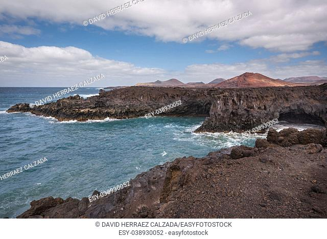 Lanzarote landscape. Los Hervideros coastline, lava caves, cliffs and wavy ocean. No people appears in the scene