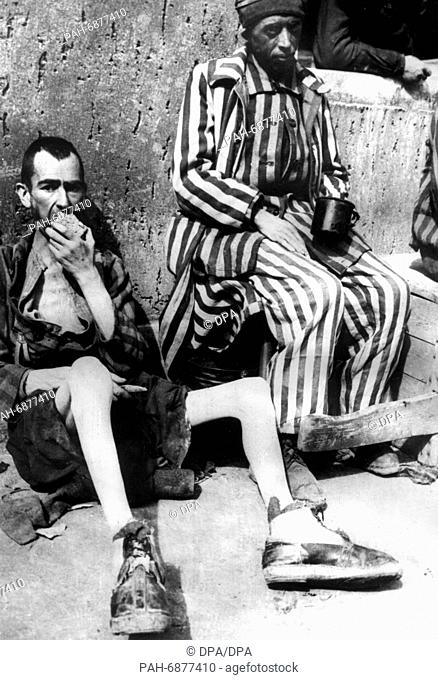 Two emaciated prisoners after the liberation of Buchenwald concentration camp on 13 April 1945 by the 3rd US Army. - Buchenwald/Germany