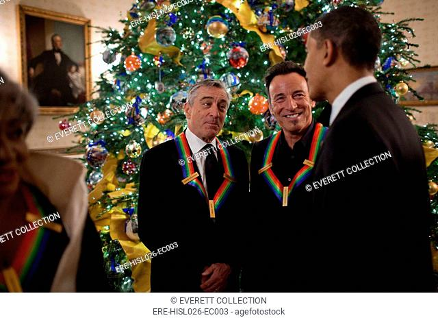 President Obama with Robert DeNiro and Bruce Springsteen both wearing their Kennedy Center Honors awards at a reception in the White House Blue Room Dec