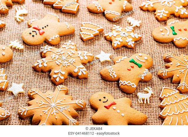 Christmas gingerbread cookies homemade and New Year decor on table with burlap tablecloth. Merry Christmas postcard