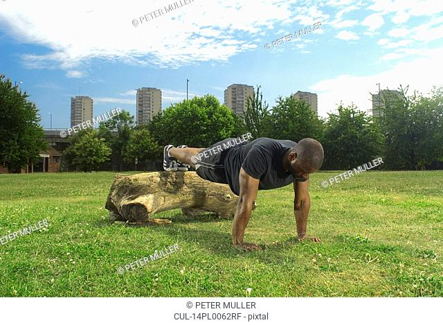 man doing press ups in park