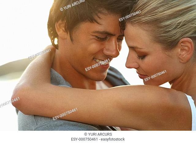 Closeup portrait of a cheerful romantic couple having fun together