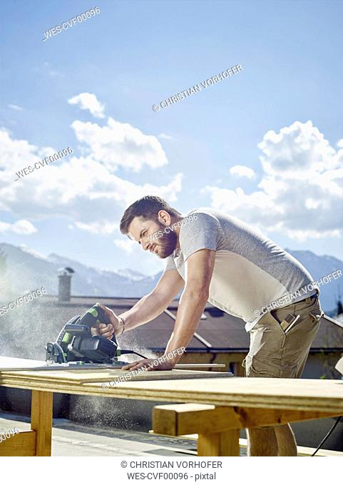 Carpenter working, circular saw