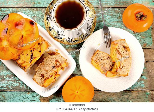 Persimmons cake with tea overhead view