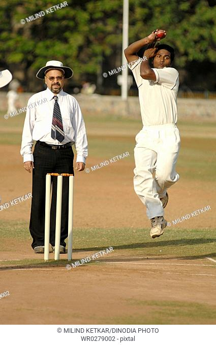 Indian fast bowler in action of bowling in cricket match MR705H705G