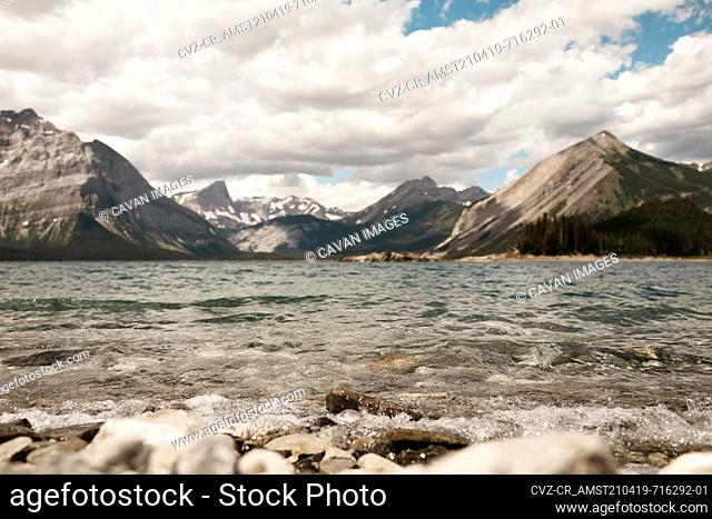 View of mountains from rocky shoreline at Upper Kananaskis Lakes